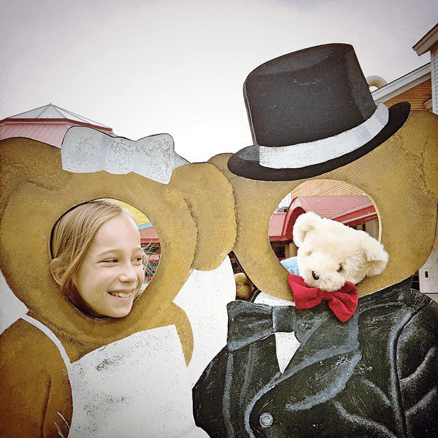 Image of a young girl with her new teddy bear at Vermont Teddy Bear Company