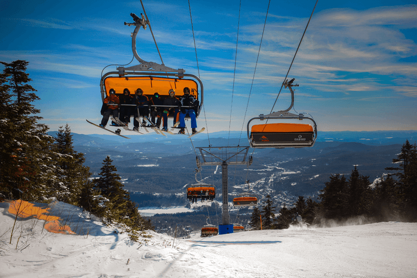 Image of skiers on ski lift at Okemo Mountain Resort