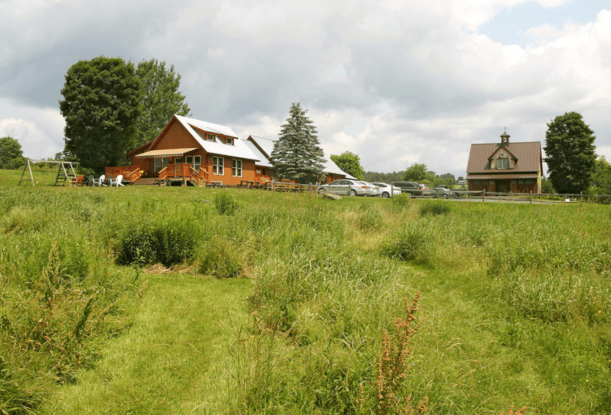 Image of the Bragg Farm Sugarhouse in summer