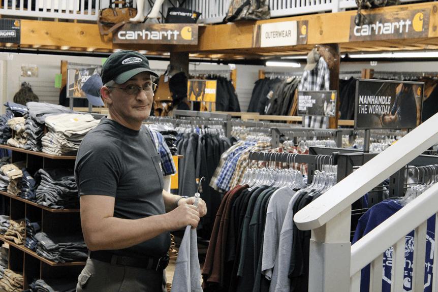 Image of man looking at Carhartt clothing at Farm-Way