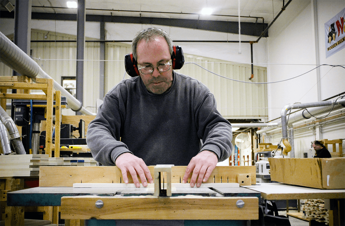 Man at the tablesaw at Maple Landmark Woodcraft