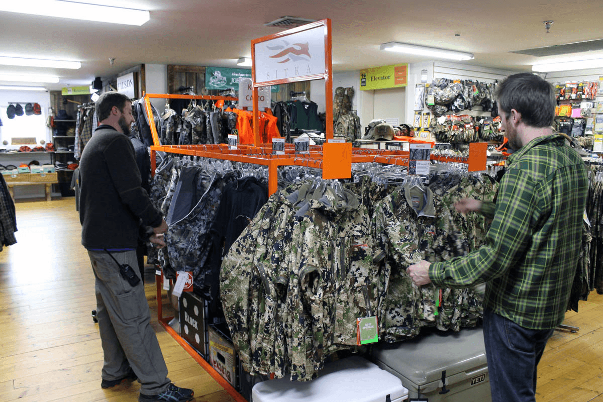 Image of men looking at hunting clothes at Farm-Way