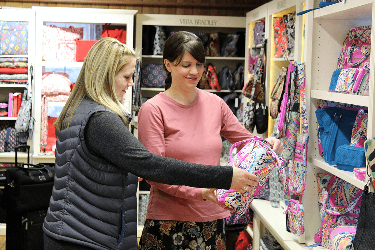 Image of women looking at handbags at Farm-Way