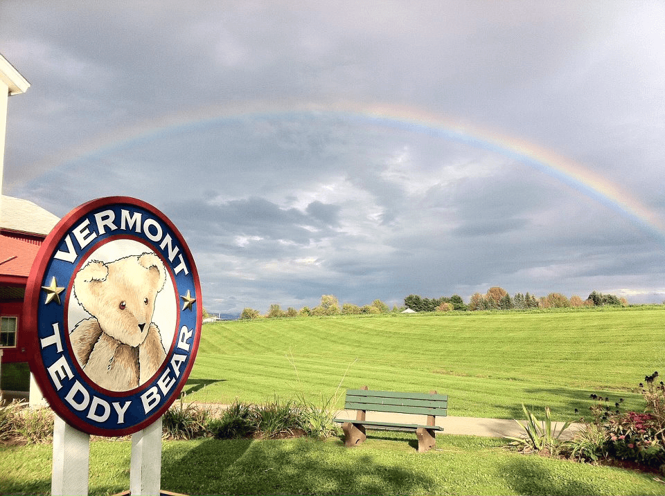Image of a rainbow over the field next to the Vermont Teddy Bear factory