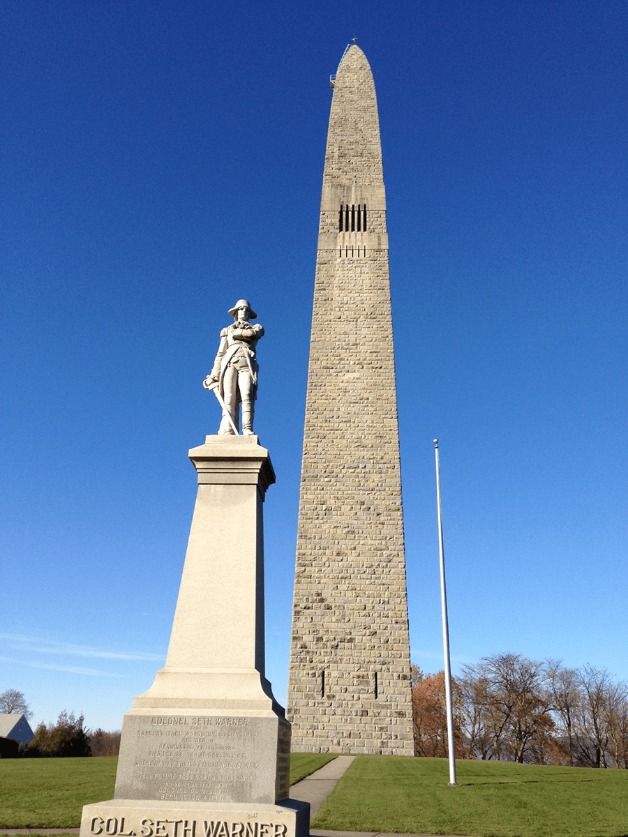 Image of Bennington Battle Monument and statue of Seth Warner a Vermont State Historic Site