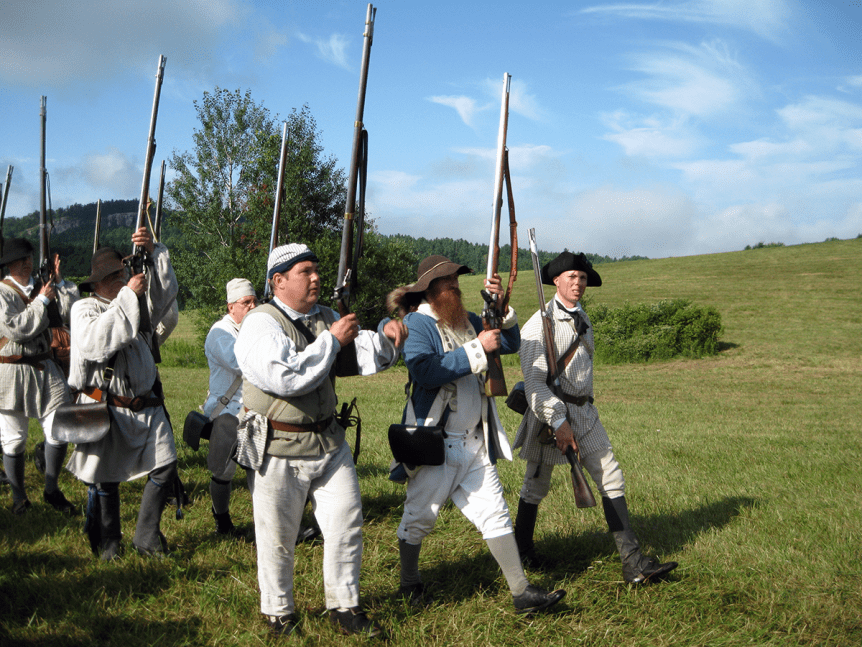 Image of reenactors at the Hubbard Battle Monument, a Vermont State Historic Site