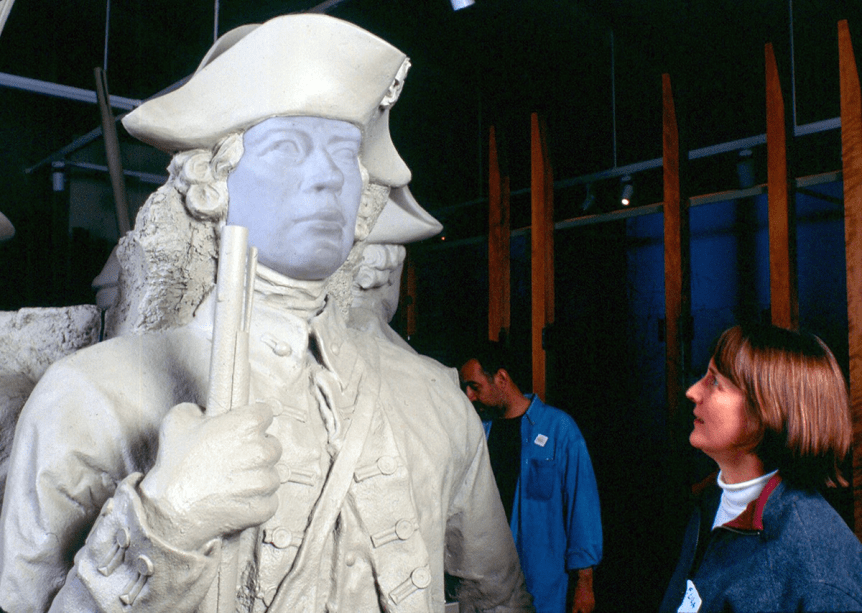 Image of a woman admiring a statue at the Mount Independence exhibit, a Vermont State Historic Site