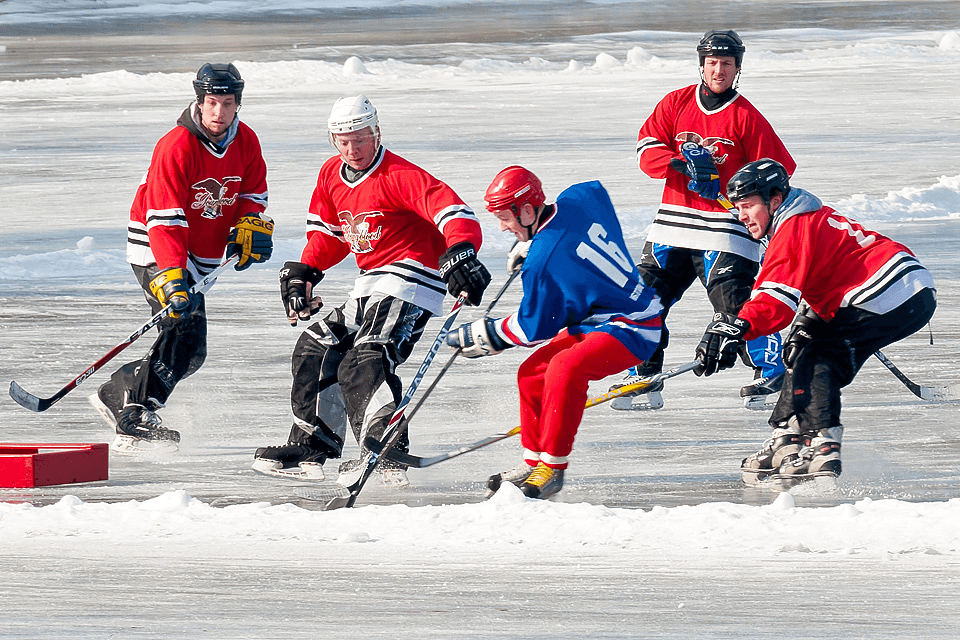 Image of men playing hockey at Lake Morey Resort