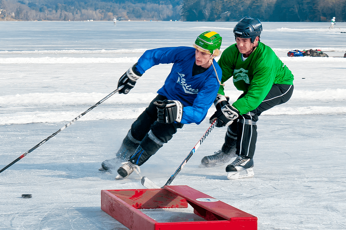 Image of 2 men playing hockey at Lake Morey Resort
