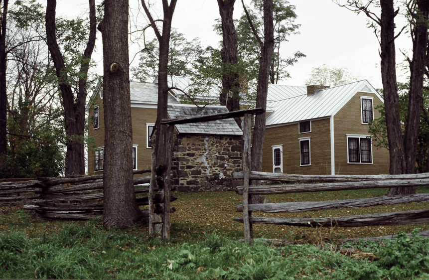 Image of smokehouse and back of the main house at Rokeby Museum