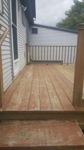 A wooden deck in Middlebury, VT that was power washed by Vermont Home Wash
