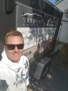 Owner of Vermont Home Wash with his versatile power washing trailer in Williston, VT