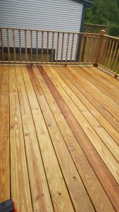 This is a recently power washed wooden deck in Middlebury, VT