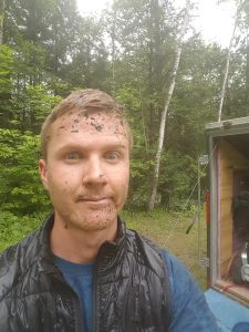 A picture of the owner of Vermont home wash with mud on his face after gutter cleaning in Burlington, VT
