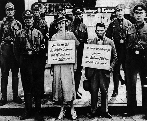 Nazis bullying people 'guilty of interracial sex', Cuxhaven, Germany, 1933