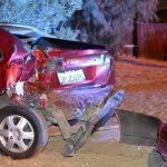 Red Nissan with rear end damage. (Photo by Diana Cabral, Victor Valley News)