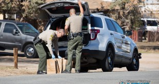 Corporal Rios, with the San Bernardino County Sheriff's Department collected over 6 bags of evidence from the home. (Gabriel D. Espinoza, Victor Valley News)
