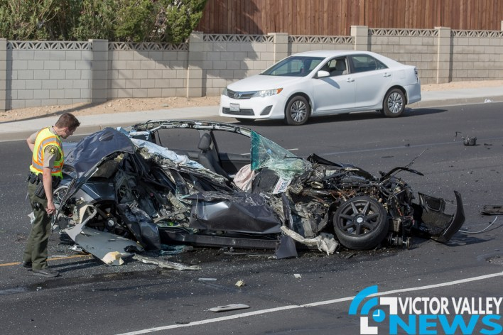 The BMW sustained major damage after crashing into the under-ride steel guards of a semi truck on Green Tree Blvd. (Gabriel D. Espinoza, Victor Valley News)