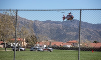 A 10-year-old riding home from school on a bike was airlifted after the child crashed into a moving school bus. (Gabriel D. Espinoza, Victor Valley News.)