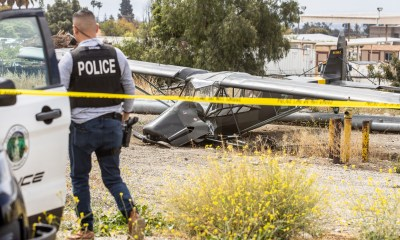 Upland Police taped-off an area in the field around the small plane crash. (Hugo. C. Valdez, Victor Valley News)