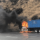 A trash truck caught fire on the northbound I-15 in the cajon pass Thursday morning. (Photo Christopher Webb-Miranda)