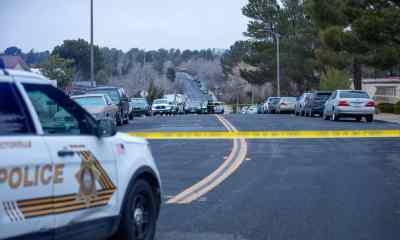 CSI photograph the scene where a man was murdered. (Hugo C. Valdez, VVNG.com)