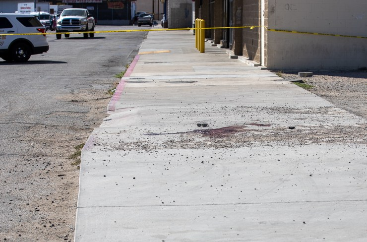 A pool of blood and the victims sunglasses were visible on the sidewalk. (Hugo C. Valdez, VVNG.com)