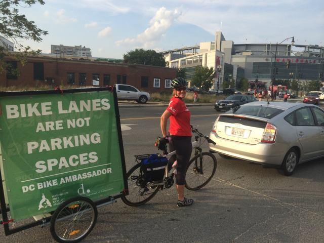 A Bike Ambassador helps pull a trailer down in SE DC
