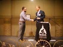 WABA Executive director congradulating DDOT Director Leif Dormsjo