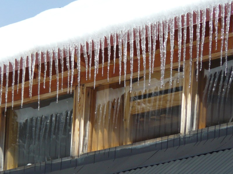 Photo of House roof with snow and ice