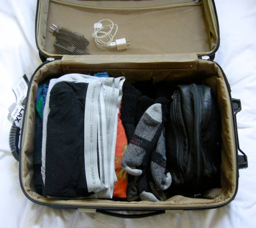 PACKING_A_SUITCASE_NEATLY_PACKED_WITH_TOILETRIES