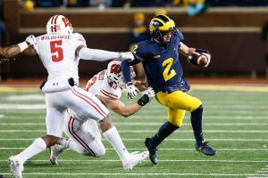 The Badgers are favored by 3.5 points over the Wolverines at home