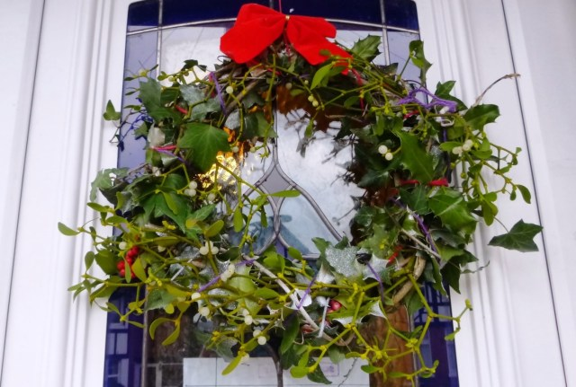 A Christmas wreath with holly, ivy, and mistletoe is toxic for pets