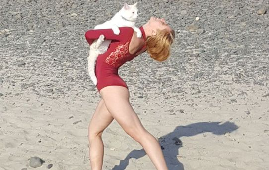 We took my cat to the beach and there happened to be a professional dancer having a photo shoot