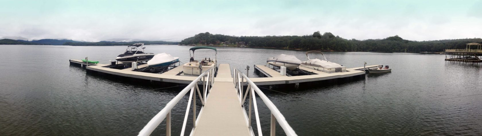 wahoo aluminum docks commercial marine construction hideaway curved dock with multiple slips wide angle shot