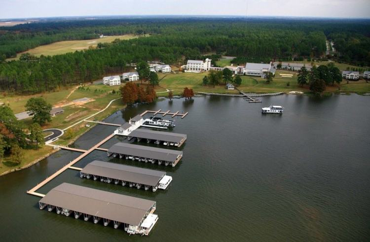 wahoo aluminum docks marina - commercial docks with gable roof and ipe covered walkways