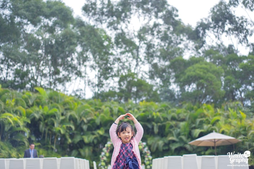 a girl dancing in a hk lawn wedding