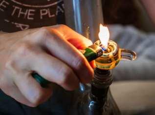 How To Clean A Bong - Lighting a bowl of Cannabis