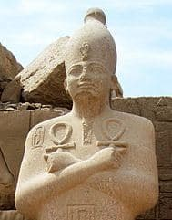 An ancient statue of Osiris with his right arm crossed over his left (copyright Olaf Tausch 1April2009).