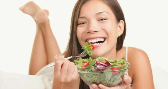 happy-woman-eating-salad