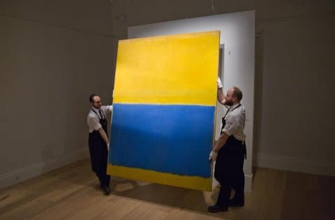 employees-of-sothebys-auction-house-pose-with-us-artist-mark-rothkos