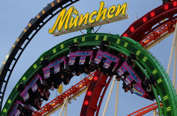 MUNICH, GERMANY - SEPTEMBER 18: Visitors ride a roller coaster during the opening day of the Oktoberfest at Theresienwiese on September 18, 2010 in Munich, Germany. 2010 marks the 200th anniversary of Oktoberfest.The Oktoberfest tradition started in 1810 to celebrate the October 12th marriage of Bavarian Crown Prince Ludwig to the Saxon-Hildburghausen Princess Therese. The citizens of Munich were invited to join in the festivities which were held over five days on the fields in front of the city gates. The main event of the original Oktoberfest was a horse race. The world's biggest beer festival will last this year from September 18 to October 4. (Photo by Alexandra Beier/Getty Images)