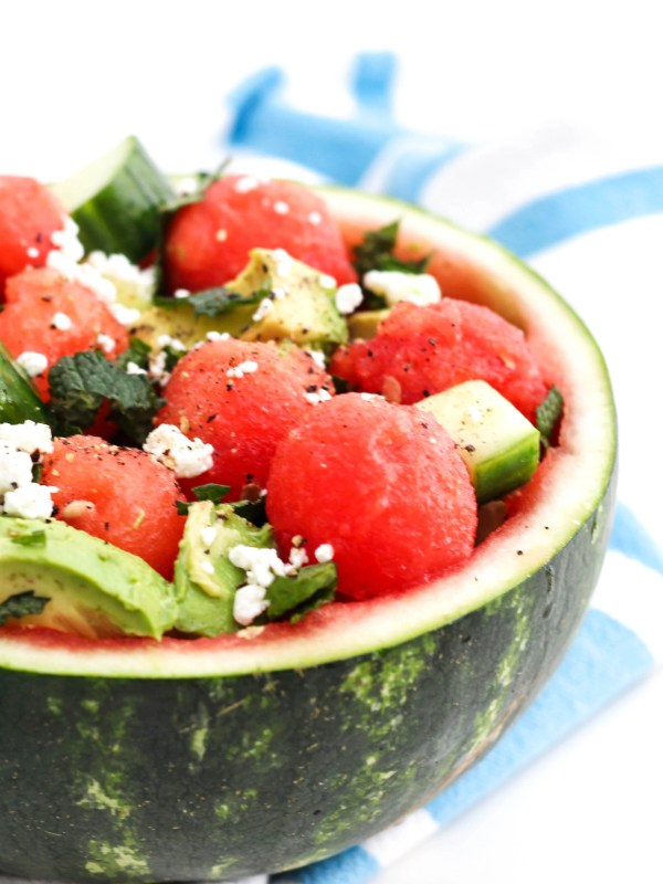 Watermelon salad with cucumber, avocado, feta, and mint served in the watermelon rind