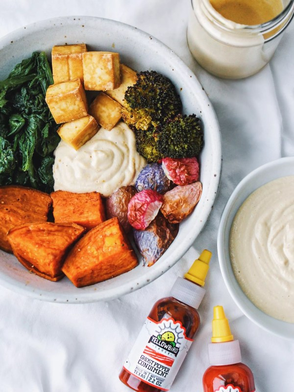 Macro bowl with roasted vegetables and a spicy vegan cashew cream sauce