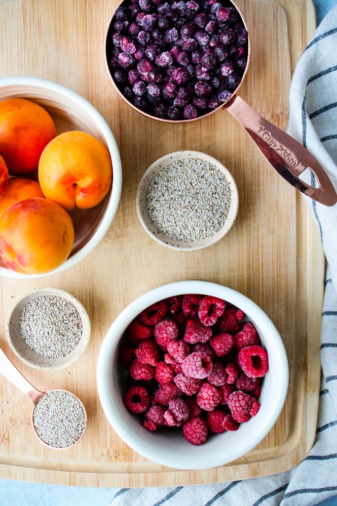 ingredients for blueberry, raspberry, and apricot chia seed jam