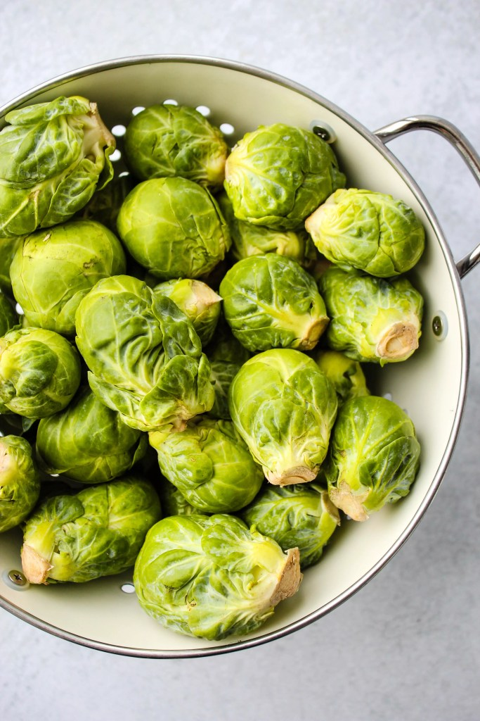 brussels sprouts in a white colander