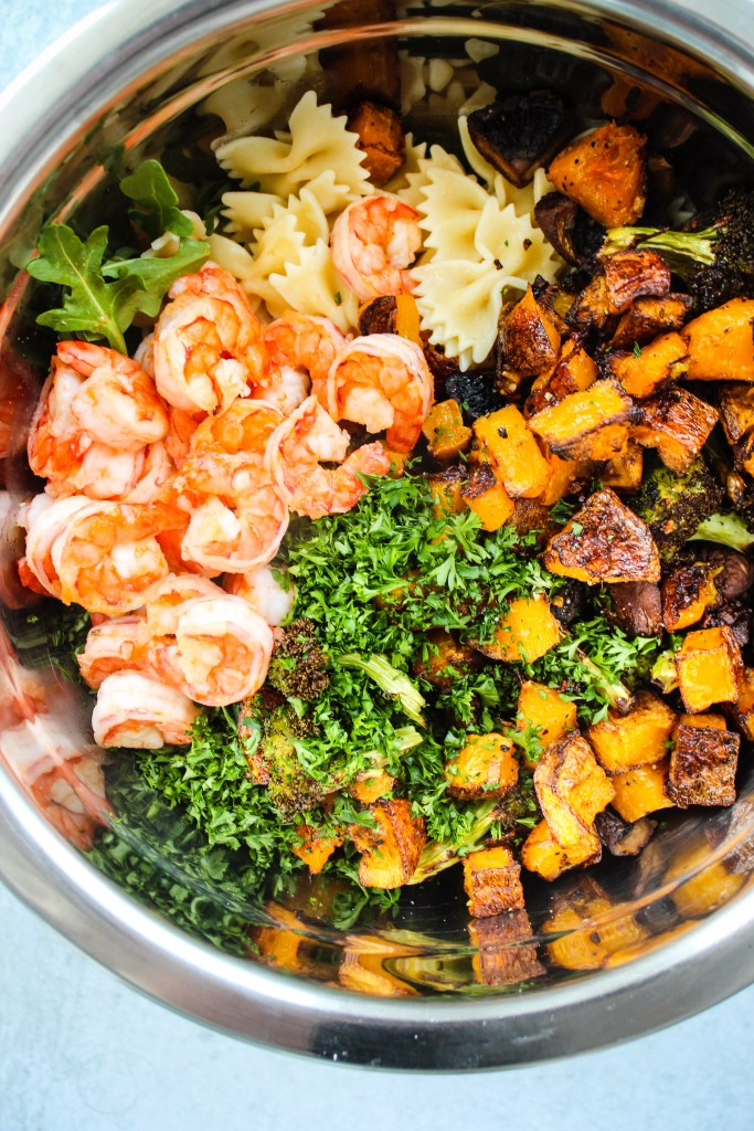 bowl with shrimp, parsley, roasted butternut squash, mushrooms, broccoli, and pasta