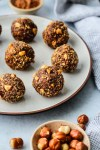 white plate with chocolate hazelnuts bliss balls