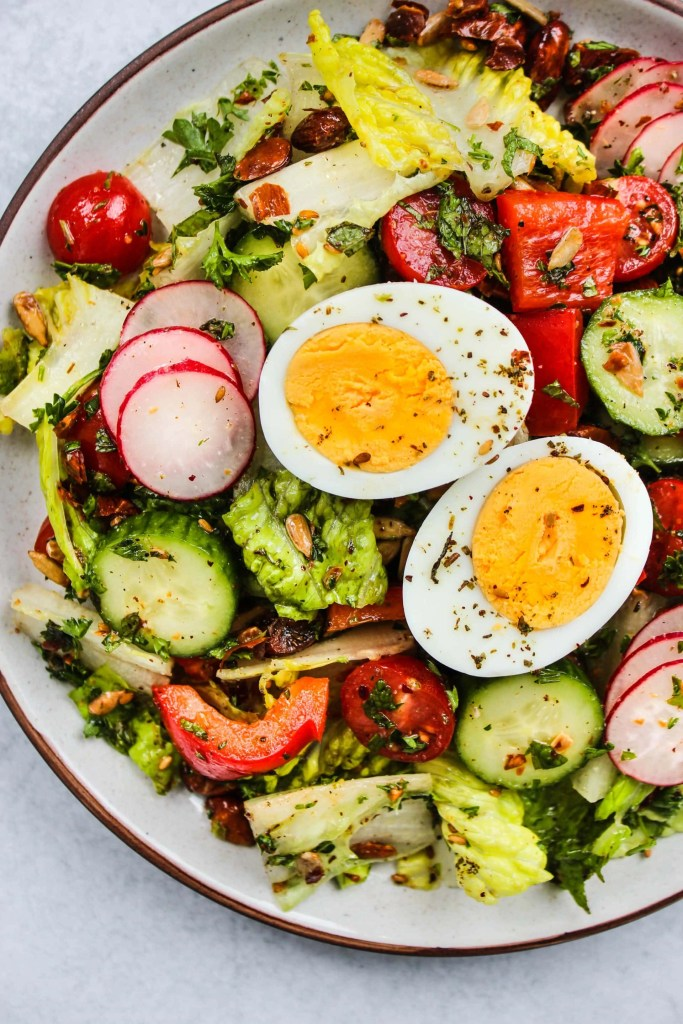 plate with crunchy chopped romaine salad and hard boiled egg