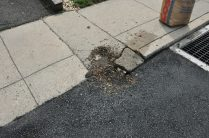 This shows the damage caused to this resident's driveway apron. The borough also removed the required apron threshold and didn't replace it.